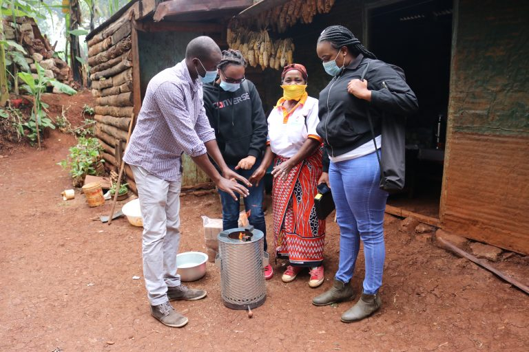 Kenya EnSo Team warming by a stove